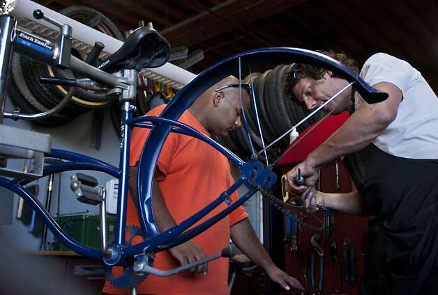 Jeremy Cavagnolo, right, helps Michael Brown, volunteer, build the bikes that they try to sell at The Crucible on Saturday, July 14, 2012 in Oakland, Calif. Photo: Yue Wu, The Chronicle