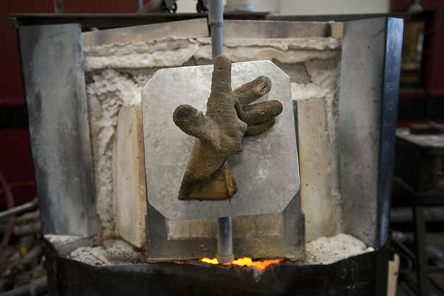A glove attached to the kiln is photographed at The Crucible on Saturday, July 14, 2012 in Oakland, Calif. Photo: Yue Wu, The Chronicle