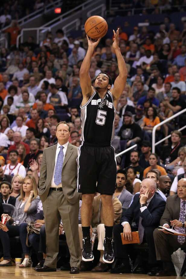 Cory Joseph #5 of the San Antonio Spurs shoots the ball against the Phoenix Suns during the NBA game at US Airways Center on April 25, 2012 in Phoenix, Arizona. The Spurs defeated the Suns 110-106. NOTE TO USER: User expressly acknowledges and agrees that, by downloading and or using this photograph, User is consenting to the terms and conditions of the Getty Images License Agreement. (Photo by Christian Petersen/Getty Images) *** Local Caption *** Cory Joseph Photo: Christian Petersen, Getty Images / 2012 Getty Images