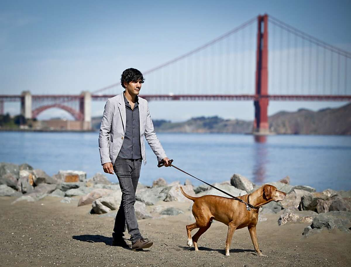 Jeremy Stoppelman, co-founder and CEO and Director of Yelp, the crowd-sourced review site, is seen at Crissy Field with his dog, Darwin, on Tuesday, June 26, 2012 in San Francisco, Calif.