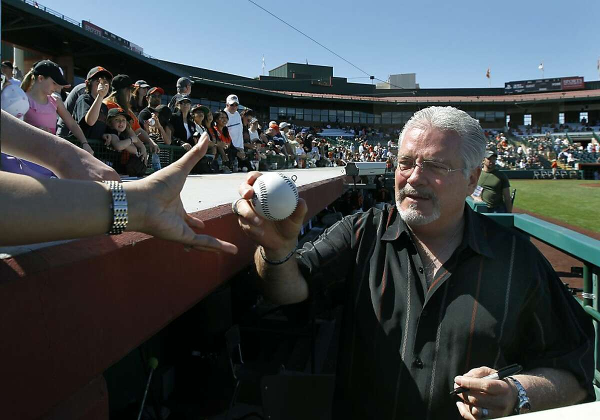 General Manager Brian Sabean autographs baseballs for fans before the San Francisco Giants Cactus League spring training opener against the Arizona Diamondbacks in Scottsdale, Ariz. on Saturday, March 3, 2012.