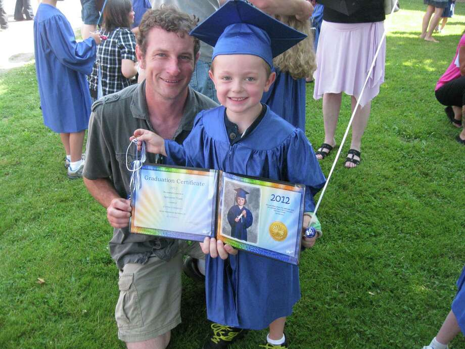 Nathan Towle, 5, of Gallupville, smiles beside his father Brad Towle at the Schoharie kindergarten graduation on June 21, 2012. It was the first class since Tropical Storm Irene. (Colleen Towle)
