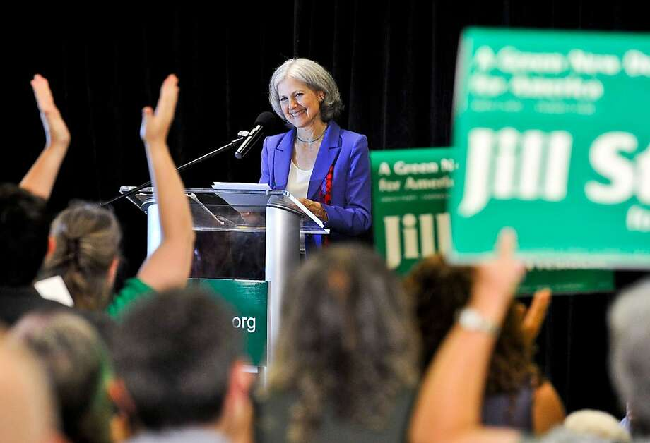 Green Party presidential candidate Jill Stein delivers her acceptance speech at the Green Party's convention in Baltimore on Saturday, July 14, 2012. Stein, a doctor who ran against Mitt Romney for Massachusetts governor a decade ago won the chance to challenge him again on Saturday, this time as the Green Party's presidential nominee. The internist from Lexington, Mass. blasted both Romney and President Barack Obama, saying both had become too dependent on donations from corporations in order to acquire office at the expense of the nation's citizens. (AP Photo/Laura-Chase McGehee) Photo: Laura-Chase McGehee, Associated Press