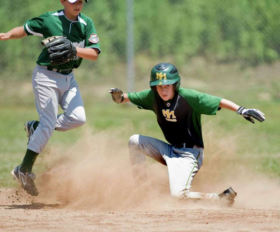 New Milford's Austin Swanson slides safely into second in the Cal Ripken 11-year-old baseball game against Dover New Hampshire, played at Garick Farms Park in New Milford. Saturday, July 14, 2012 Photo: Scott Mullin / The News-Times Freelance