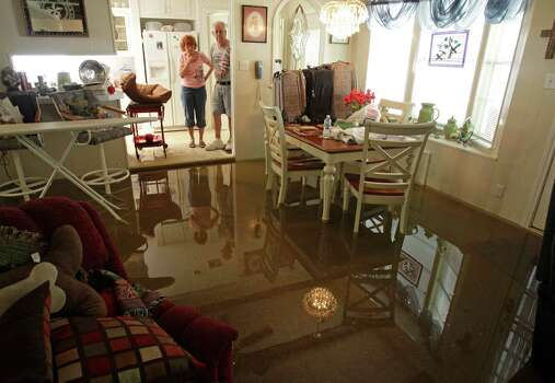 "Janet and Jerry Turner are hoping the rain that left floodwaters in the sunken den of their home on Pine Belt in Cypress has stopped. But Jerry Turner said they know ""we're at the mercy of the man upstairs."" Photo: Melissa Phillip / © 2012 Houston Chronicle"