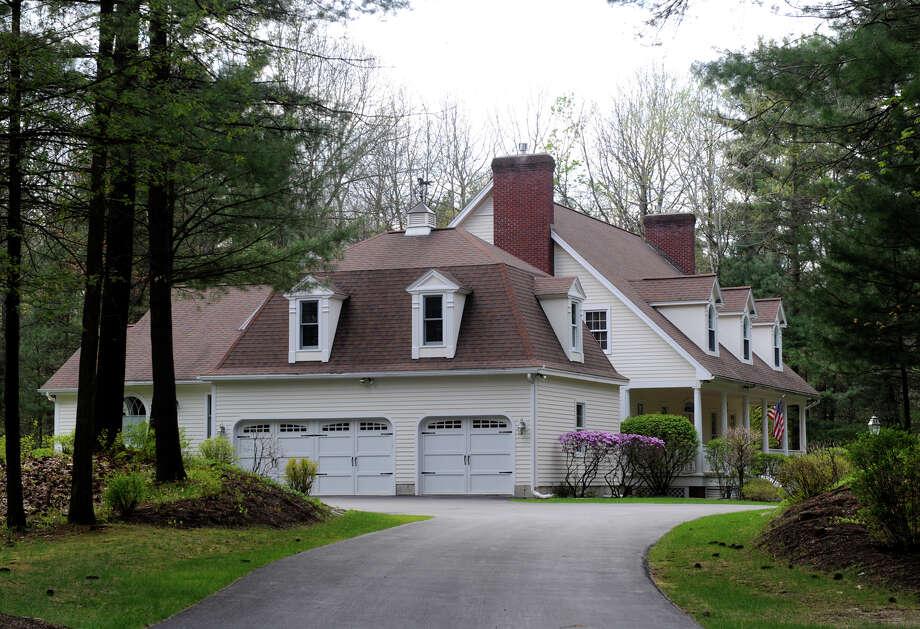 Citizens Bank has asked a federal judge to allow it to sell the residence of David and Lynn Smith at 2 Rolling Brook in Saratoga Springs. The bank said some of the money could be used to repay the victims of an alleged fraud scheme involving Smith's former brokerage, McGinn, Smith & Co. The couple have not made a mortgage payment since May 2011. (Times Union file photo ) Photo: Skip Dickstein