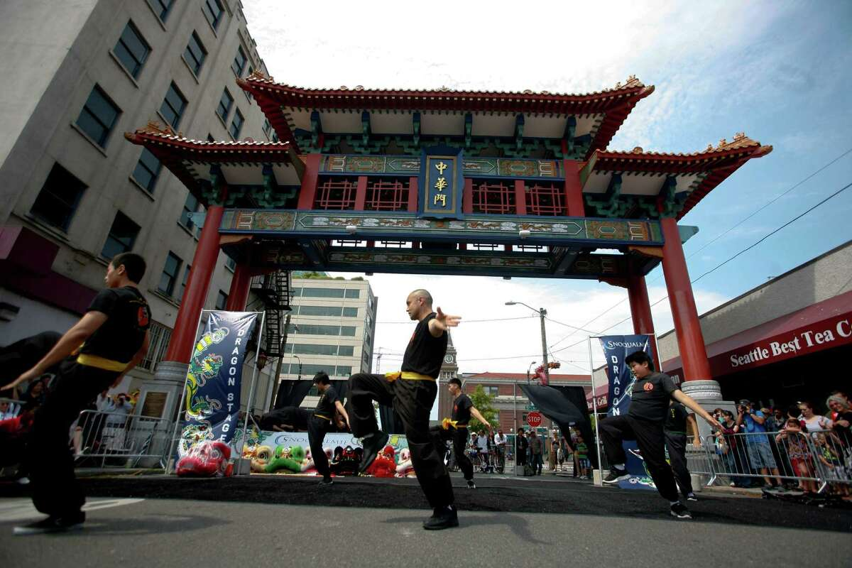 Members of the Mak Fai Washington Kung Fu Club perform at the Chinatown-ID Dragon Fest in Seattle's International District on Saturday, July 14, 2012.