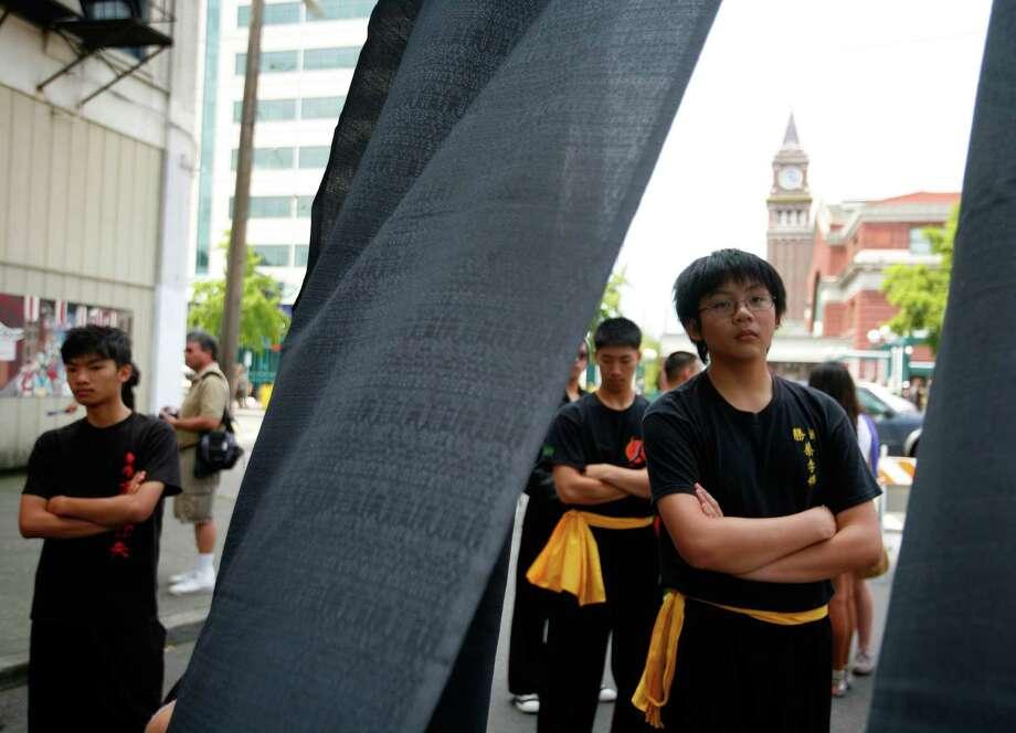 Members of the Mak Fai Washington Kung Fu Club watch a performance. Photo: Sofia Jaramillo / SEATTLEPI.COM
