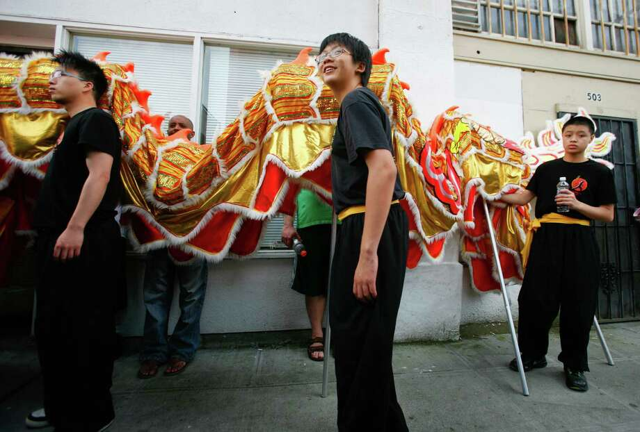 Members of the Mak Fai Washington Kung Fu Club hold a dragon puppet. Photo: Sofia Jaramillo / SEATTLEPI.COM
