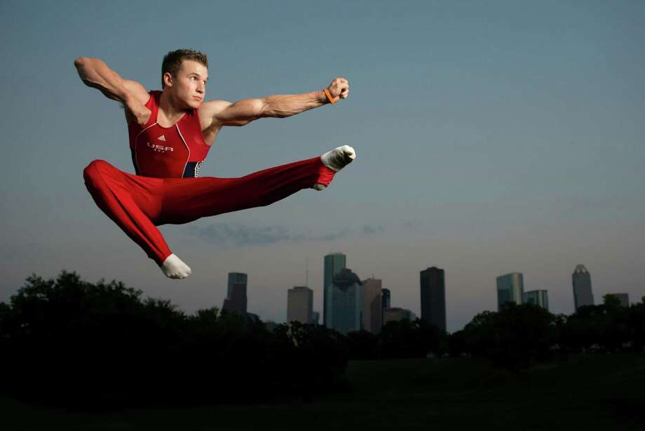 Olympic gymnast Jonathan Horton will compute in the London Olympics. He photographed with the Houston skyline. Photo: Smiley N. Pool, Houston Chronicle / © 2012  Houston Chronicle