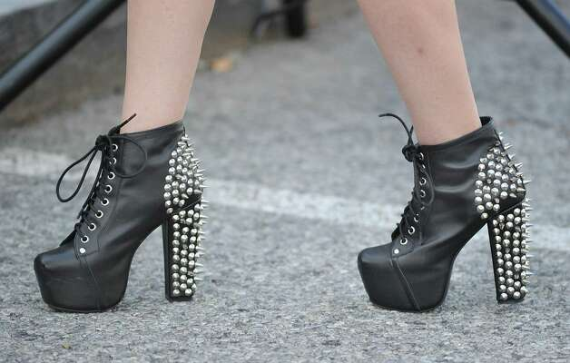 The spikey platform shoes of Tracy Moavero of Stamford during the Bastille Day street party on Lewis Street in Greenwich, Saturday night, July 14, 2012. The event was hosted by Restaurant Jean-Louis and the Alliance Française of Greenwich. Photo: Bob Luckey / Greenwich Time