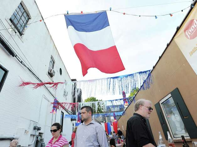 The French flag during the Bastille Day street party on Lewis Street in Greenwich, Saturday night, July 14, 2012. The event was hosted by Restaurant Jean-Louis and the Alliance Française of Greenwich. Photo: Bob Luckey / Greenwich Time