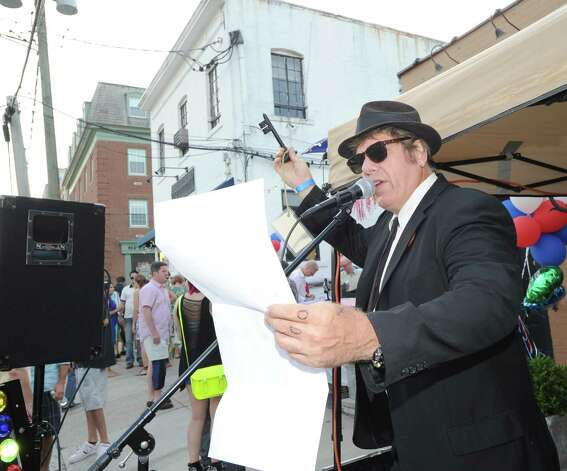 Elwood, aka Pat Dougherty of Stamford of the band Blues Patrol, holds up a ceremonial key to the Bastille during the Bastille Day street party on Lewis Street in Greenwich, Saturday night, July 14, 2012. The event was hosted by Restaurant Jean-Louis and the Alliance Française of Greenwich. Photo: Bob Luckey / Greenwich Time