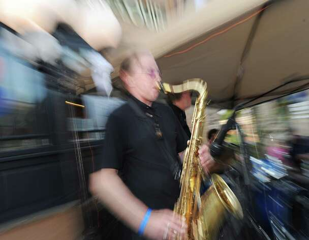 Pierre Guertin of the band Blues Patrol plays the saxophone during the Bastille Day street party on Lewis Street in Greenwich, Saturday night, July 14, 2012. The event was hosted by Restaurant Jean-Louis and the Alliance Française of Greenwich. Photo: Bob Luckey / Greenwich Time