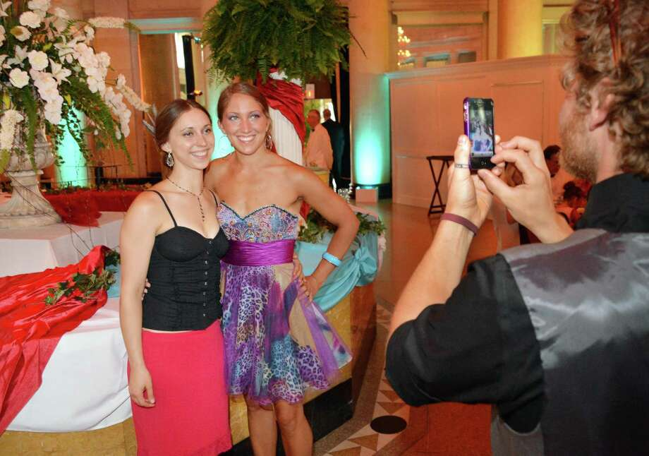 Becca Astulos, left, of Kingston, and Sally Murphy of Saratoga Springs have their picture taken by Jerermy Litts, at right, of Saratoga Springs during the New York City Ballet Gala at the Saratoga Performing Arts Center in Saratoga Springs Saturday July 14, 2012.  (John Carl D'Annibale / Times Union) Photo: John Carl D'Annibale