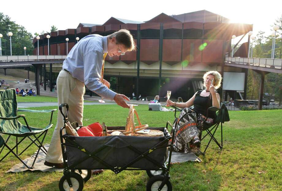 Bill Schanck and wife Gail Haulenbeek of Delmar picnic on the lawn before the New York City Ballet at the Saratoga Performing Arts Center in Saratoga Springs Saturday July 14, 2012.  (John Carl D'Annibale / Times Union) Photo: John Carl D'Annibale