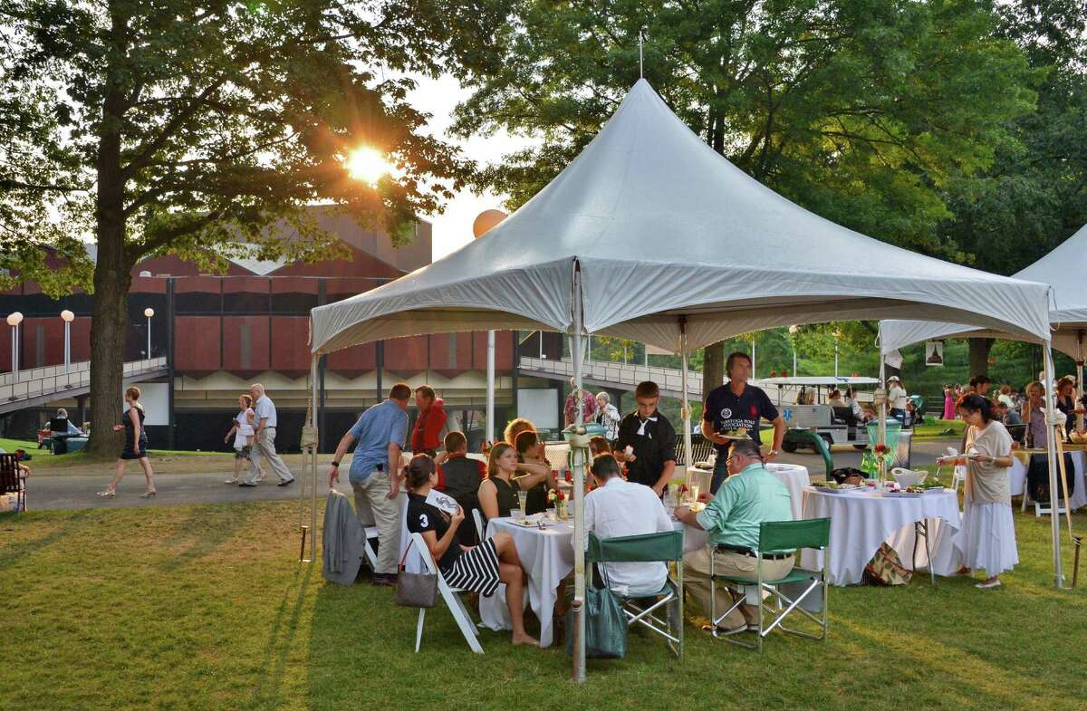 Picnicing under a tent at the New York City Ballet Gala at the Saratoga Performing Arts Center in Saratoga Springs Saturday July 14, 2012. (John Carl D'Annibale / Times Union)