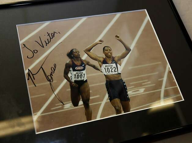 There are several pictures of track star Marion Jones on the walls of Victor Conte's offices. Victor Conte, of BALCO fame,  has reinvented himself as an opponent of performance enhancing steroids, and a proponent of tougher drug testing measures. Photo: Brant Ward, The Chronicle