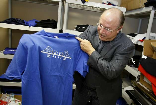 "Victor Conte has some fun with ""BALCO gear"" souvenir shirts. Victor Conte, of BALCO fame,  has reinvented himself as an opponent of performance enhancing steroids, and a proponent of tougher drug testing measures. Photo: Brant Ward, The Chronicle"