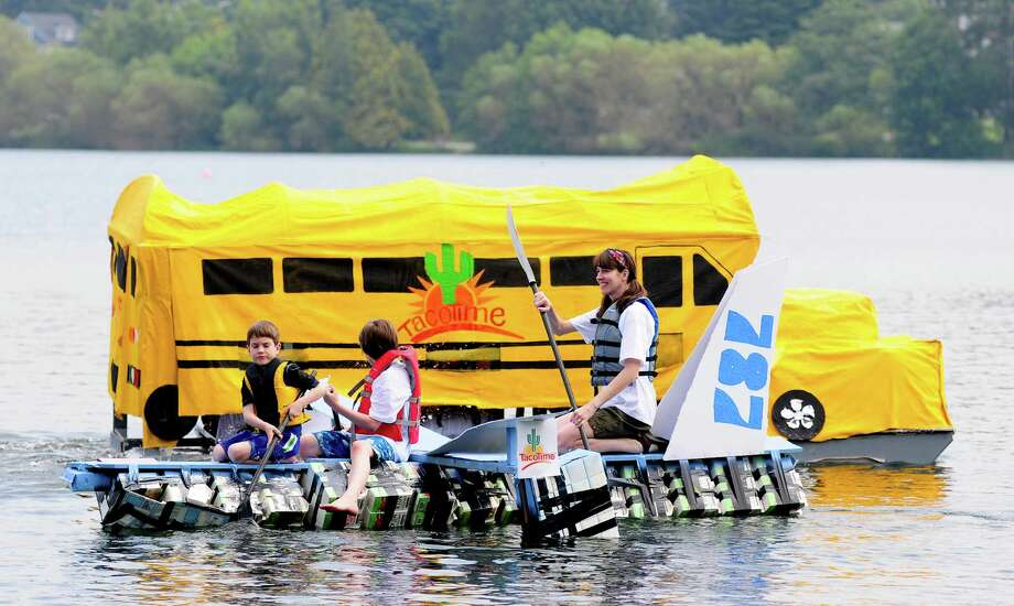 """Two boats present an unusual sight as a """"787"""" passes a school """"bus."""" Photo: LINDSEY WASSON / SEATTLEPI.COM"""