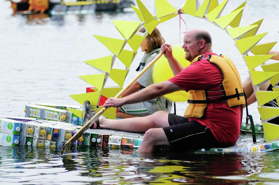 Participants paddle out to the lake in a sun-themed boat. Photo: LINDSEY WASSON / SEATTLEPI.COM