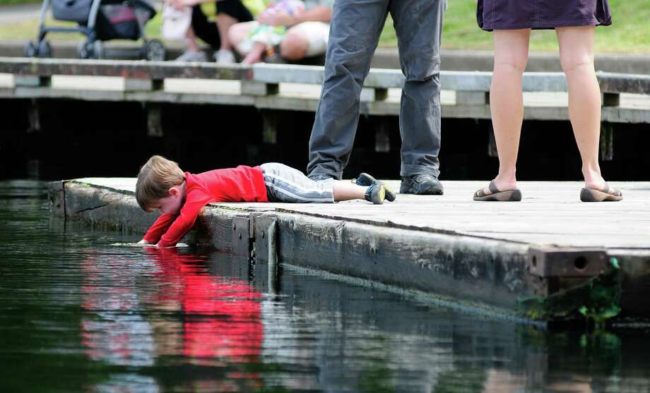 A young boy plays in the water. Photo: LINDSEY WASSON / SEATTLEPI.COM