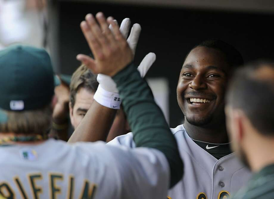 MINNEAPOLIS, MN - JULY 14: Chris Carter #22 of the Oakland Athletics celebrates a three run home run against the Minnesota Twins during the first inning on July 14, 2012 at Target Field in Minneapolis, Minnesota. (Photo by Hannah Foslien/Getty Images) Photo: Hannah Foslien, Getty Images