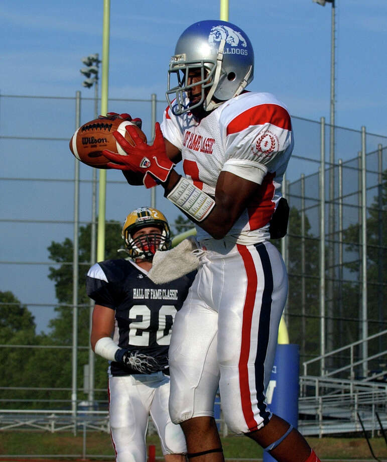 Bunnell's Jawad Chisholm catches the ball in the endzone for a touchdown, during Hall of Fame Classic football action in West Haven, Conn. on Saturday July 14, 2012. Photo: Christian Abraham / Connecticut Post