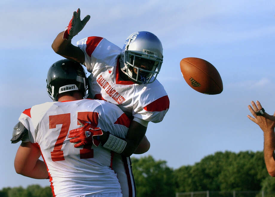 Bunnell's Jawad Chisholm tosses back the ball to the ref after getting a touchdown, during Hall of Fame Classic football action in West Haven, Conn. on Saturday July 14, 2012. Photo: Christian Abraham / Connecticut Post