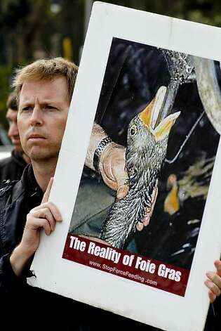 Craig Stevens joins fellow animal rights protesters gathered in front of the Presidio Social Club San Francisco, Calif. on Saturday July 14, 2012. Protesters are against the restaurant making foie gras available on this evening's menu, since a California state law banned products from force fed ducks. Presidio Social Club is on federal land. Photo: Michael Macor, The Chronicle