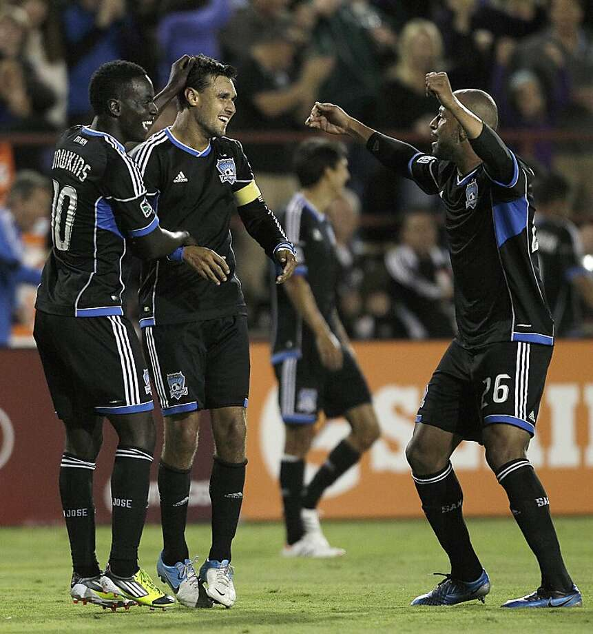 San Jose Earthquakes' Chris Wondolowski, center, celebrates with Simon Dawkins, left, and Victor Bernardez after scoring his third goal of the game against Real Salt Lake during the second half of an MLS soccer game in Santa Clara, Calif., Saturday, July 14, 2012. (AP Photo/Jeff Chiu) Photo: Jeff Chiu, Associated Press