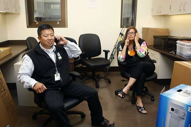 Recreation and parks sports and athletics supervisor Jimmy Chen (left) and recreation and parks community service supervisor Terry Trejo (right) on the phone as they prepare for the opening of the newly constructed Chinese Recreation Center in San Francisco, Calif., on Thursday, July 12, 2012. Photo: Liz Hafalia, The Chronicle