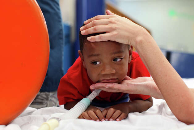 Braylon Nelson, 2, needs extra support to hold his head up as he undergoes physical therapy at CHRISTUS Santa Rosa Children's Hospital in San Antonio on Thursday, July 5, 2012. Photo: Lisa Krantz, San Antonio Express-News / San Antonio Express-News