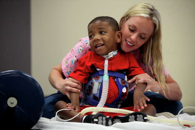 Occupational therapist Revi Hawley works with Braylon Nelson, 2, at CHRISTUS Santa Rosa Children's Hospital in San Antonio on Thursday, July 5, 2012. Photo: Lisa Krantz, San Antonio Express-News / San Antonio Express-News
