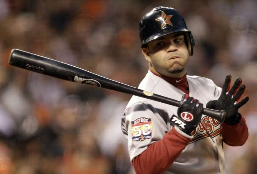 Houston Astros' Jose Altuve waits for the call on a strike from San Francisco Giants' Tim Lincecum i