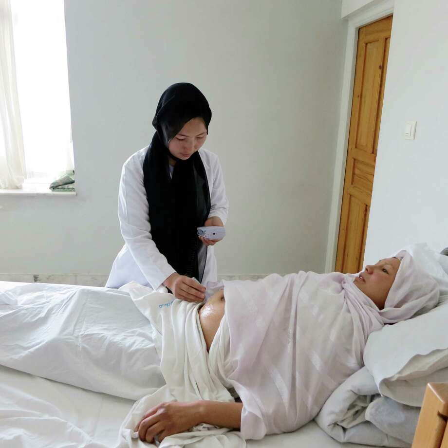 A midwife at Afshar Hospital in Kabul, Afghanistan uses one of the Dopplers donated by CooperSurgical in Trumbull, Conn. to evaluate a fetal heart rate. Photo: Contributed Photo/Afshar Hospita, Photo Courtesy Of Afshar Hospita / Connecticut Post Contributed Afshar Hospital