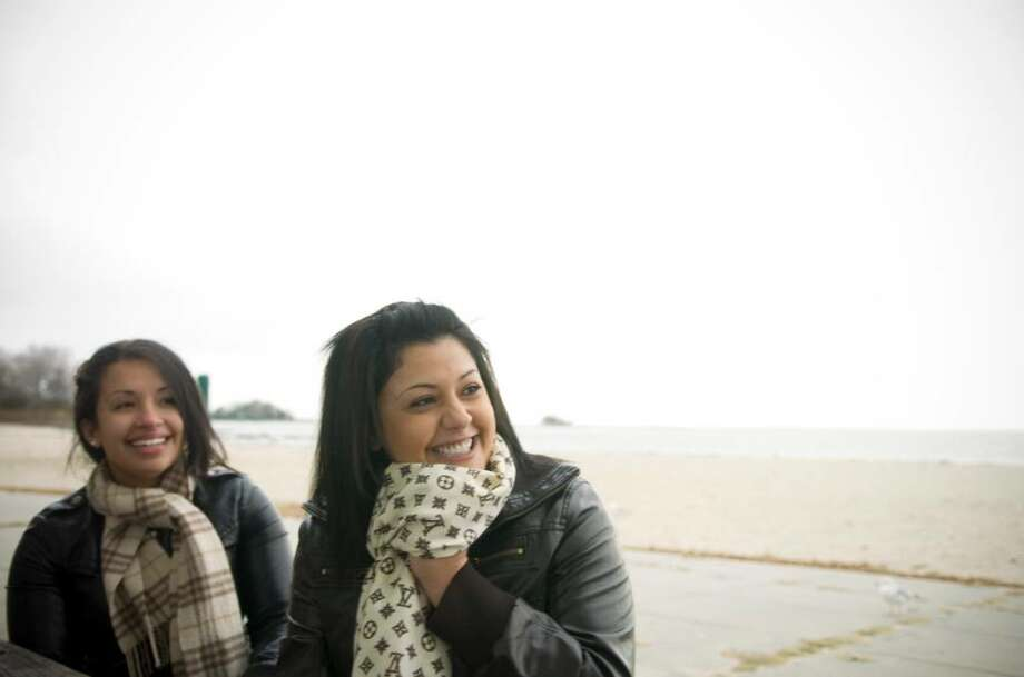 Steph Rodriguez, 20, left, and Elina Yacob, 22, right hang out at Cummings Beach in Stamford, Conn. on Monday, Nov. 23, 2009. Photo: Chris Preovolos / Stamford Advocate
