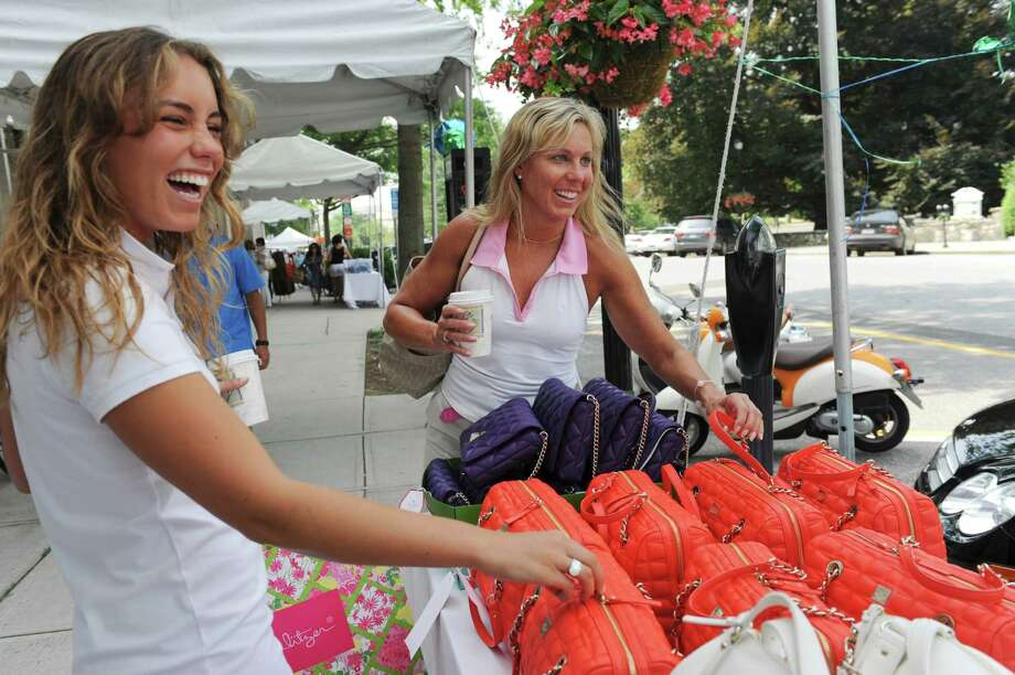 Cara Parks, 20, with her mother Sandy, of New Canaan, look at bags at Kate Spade during the Greenwich Chamber of Commerce 2012 Sidewalk Sales Sunday, July 15, 2012. Photo: Helen Neafsey / Greenwich Time