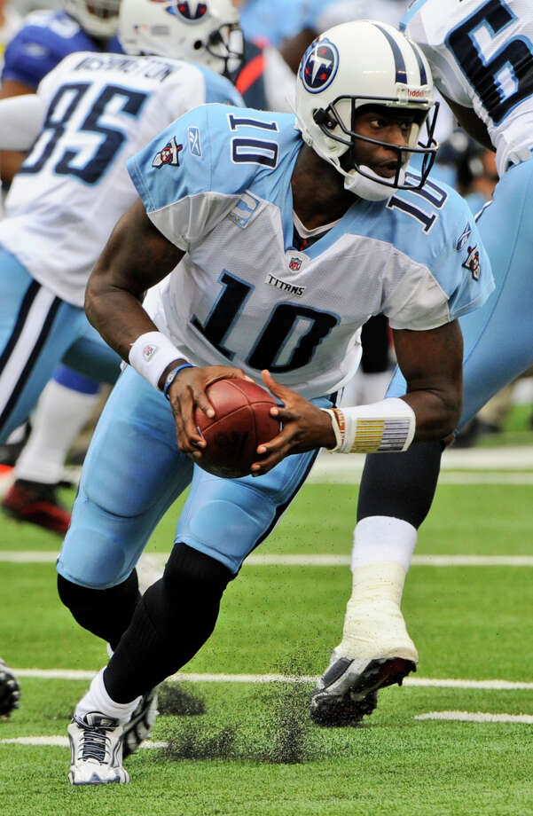 Tennessee Titans quarterback Vince Young (10) scrambles during the first quarter of an NFL football game against the New York Giants at New Meadowlands Stadium, Sunday, Sept. 26, 2010, in East Rutherford, N.J. Photo: Bill Kostroun, Associated Press