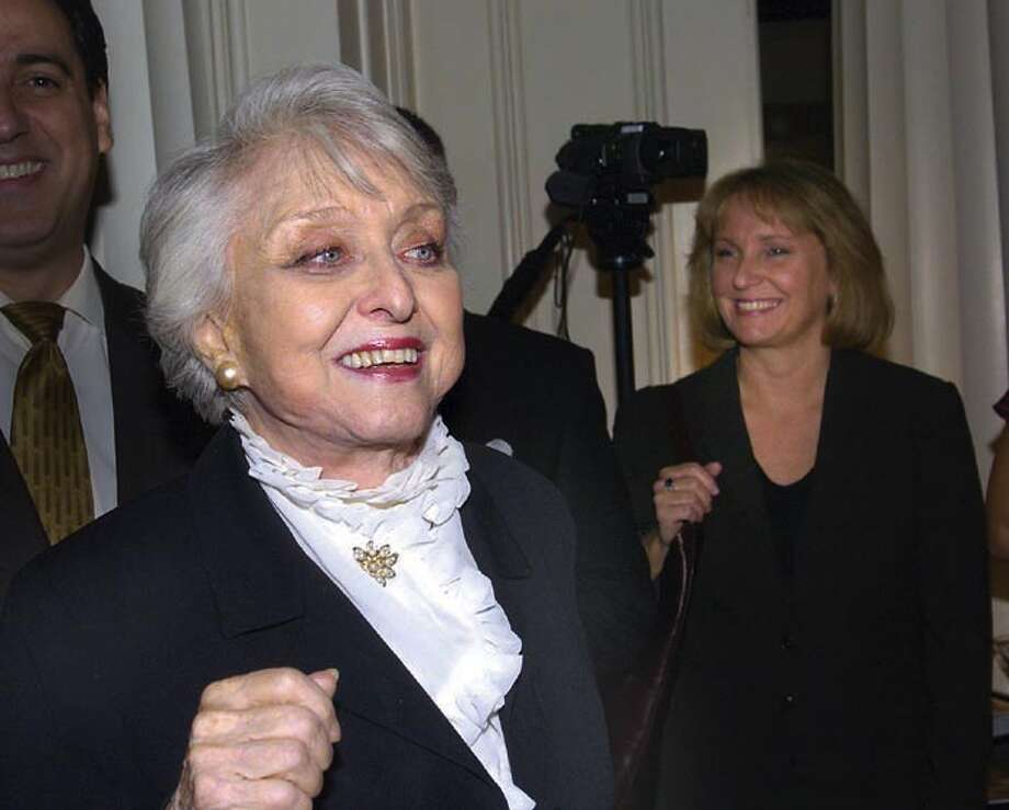 Celeste Holm, left,  makes her entrance during a 2005 Greenwich Film Festival party held in her honor in which she was presented with a Lifetime Achievement Award. Holm died in New York Sunday, July 15, 2012 at 95. Photo: Bob Luckey Jr., GT