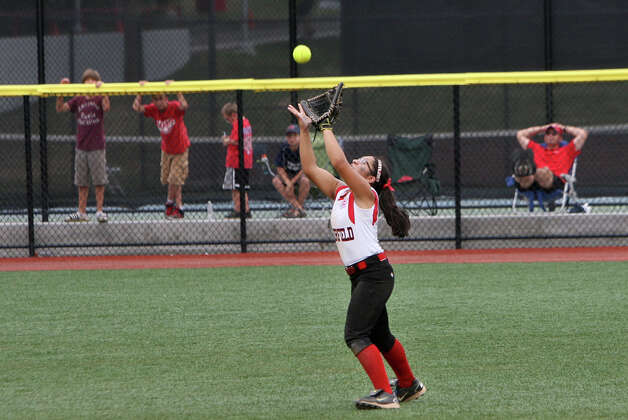 Brittany Romero, 7, makes a catch during the state championship softball game against Mystic on Sunday, June 16, 2012 at Sacred Heart University in Fairfield, Conn. Photo: Unknown, B.K. Angeletti / Connecticut Post freelance B.K. Angeletti