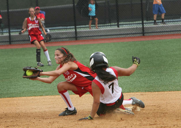 Brittany Romero, 7,slide into second during the state championship softball game against Mystic on Sunday, June 16, 2012 at Sacred Heart University in Fairfield, Conn. Photo: Unknown, B.K. Angeletti / Connecticut Post freelance B.K. Angeletti