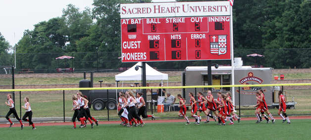 The Fairfield Little League softball team takes a victory lap with their competition from Mystic after Fairfield won the state championship on Sunday, June 16, 2012 at Sacred Heart University in Fairfield, Conn. Photo: Unknown, B.K. Angeletti / Connecticut Post freelance B.K. Angeletti