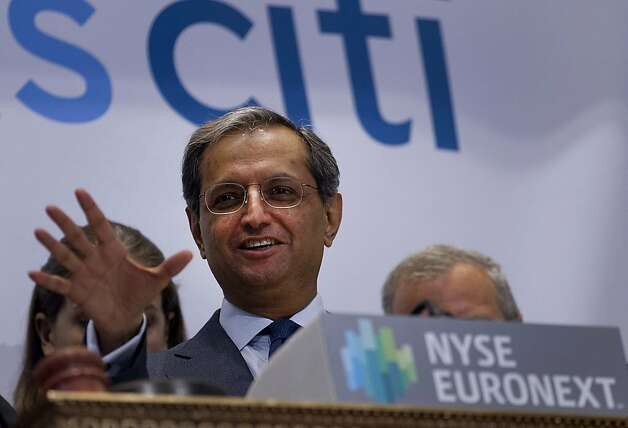 Vikram Pandit, chief executive officer of Citigroup Inc., center, rings the opening bell from the floor of the New York Stock Exchange in New York, U.S., on Monday, June 18, 2012. Citigroup Inc.  is boosting revenue at its corporate and investment banking unit in Asia with rising fees from debt underwriting and cash management as initial public offerings shrink. Photographer: Jin Lee/Bloomberg *** Local Caption *** Vikram Pandit Photo: Jin Lee, Bloomberg