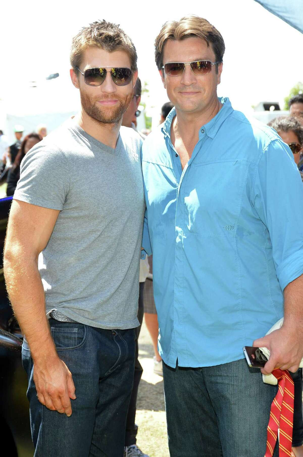 Actors Liam McIntyre and Nathan Fillion are seen.