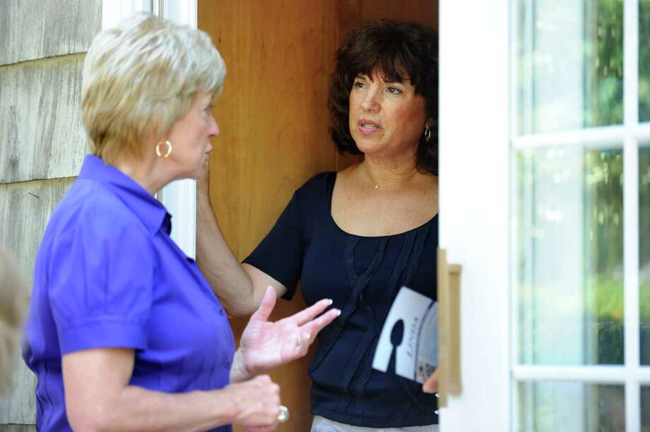 "Republican U.S. Senate candidate Linda McMahon talks with Gail Barber-Reed as she goes door-to-door Saturday, July 14, 2012 in the Rowayton section of Norwalk.  In an aim to mobilize her volunteers in a statewide initiative called ""Super Saturday,"" volunteers gathered at each of the campaign's field offices across Connecticut with a goal of making 10,000 phone calls and knocking on 10,000 doors in a single day. Photo: Autumn Driscoll / Connecticut Post"