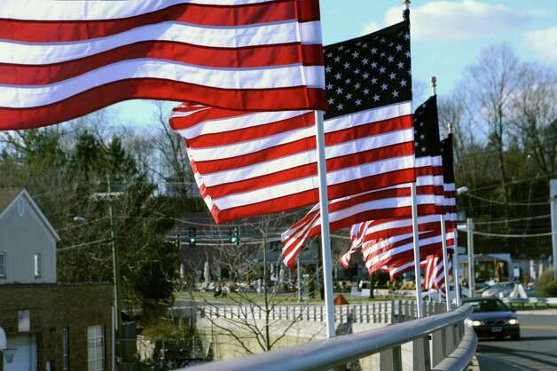 American flags fly on both sides of the Mianus River Bridge in Greenwich, Conn., in 2010. Three of the flags were vandalized Saturday, July 14, 2012, according to town officials. Photo: Helen Neafsey, ST / Greenwich Time