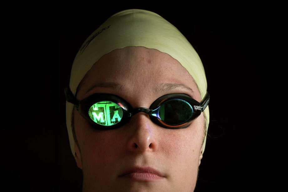 The Texas A&M logo reflects in swimmer Cammile Adams' goggles.. Photo: Smiley N. Pool, Houston Chronicle / © 2012  Houston Chronicle