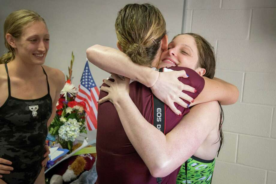 Cammile Adams, right, gets a hug from a supporter as she and Breeja Larson, left, attend a party celebrating their success at the Olympic trials. Photo: Smiley N. Pool, Houston Chronicle / © 2012  Houston Chronicle