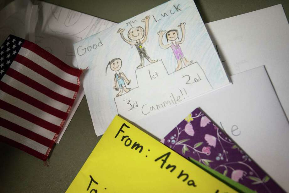 Cards left by young swimmers supporting Texas A&M swimmer Cammile Adams are seen during a party celebrating her success at the Olympic trials. Photo: Smiley N. Pool, Houston Chronicle / © 2012  Houston Chronicle